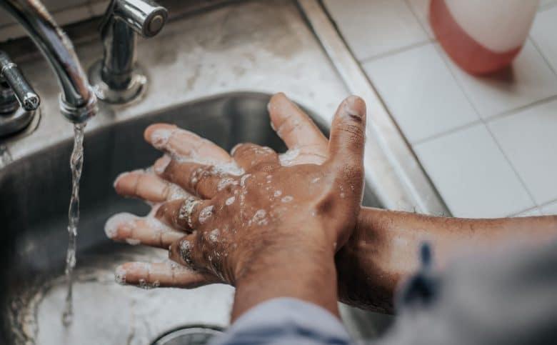 Man washing hands at a sink